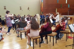 Oonagh conducts the orchestra in the final performance